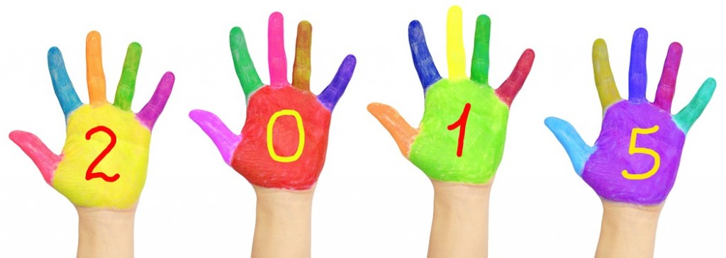 Kid`s colorful hands forming number 2015.